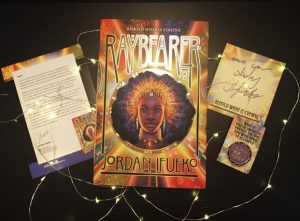 Finished copy and preorder swag for Raybearer